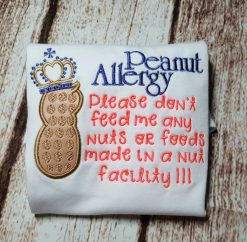 The peanut photographed has a crown for a girl but we can surely remove it for a boy. This is a great way to share with those around you when you have to leave your child with someone who doesn't know of an allergy.